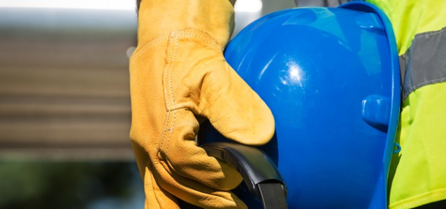 image showing a man holding a hard hat